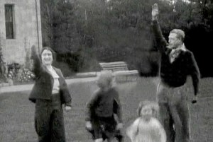 WATER MARK REMOVED BY DM ** THE SUN WORLD EXCUSIVE 18th July 2015** THE Queen and Queen Mum raise a Nazi salute in an astonishing home movie shot at Balmoral and seen today for the first time. The film shows the then Princess Elizabeth, just seven, larking about in 1933.