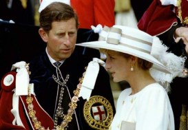 WAS116:FRANCE-DIANA:WINDSOR,ENGLAND,31AUG97 - FILE PHOTO 15JUN92- Prince Charles looks towards Princess Diana as they await their carriage to depart the Order of the Garter ceremony at Windsor Castle June 15, 1992. Diana, who was divorced from Charles in 1996, and her millionaire companion Dodi Al Fayed were killed early Sunday when their car crashed while reportedly being chased through Paris by photographers on motorcycles. rc/Kevin Lamarque-WPA REUTERS